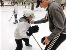 Counselor Ryan Fagan helps 11-year-old Dylan LeMaster of Painesville, Ohio, regain his balance during a blind ice hockey camp run by Envision Blind Sports and the Pittsburgh Penguins Blind Hockey at the UPMC Lemieux Sports Complex in Cranberry.