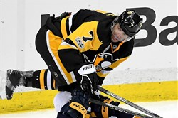 The Penguins' Matt Cullen (7) keeps the team's potential to be a legendary one on the back-burner and in perspective.