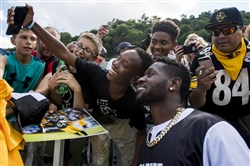 Pittsburgh Steeler Antonio Brown takes a photo with Dontay Green, 11 of Troy Hill, during Antonio Brown's celebrity softball event on Saturday at Highmark Stadium in the South Side.
