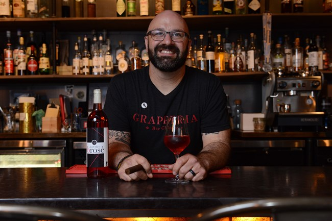 Bartender Lou DiDonato with a bottle of Sweet Lou's Brosé made by Pittsburgh Winery.
