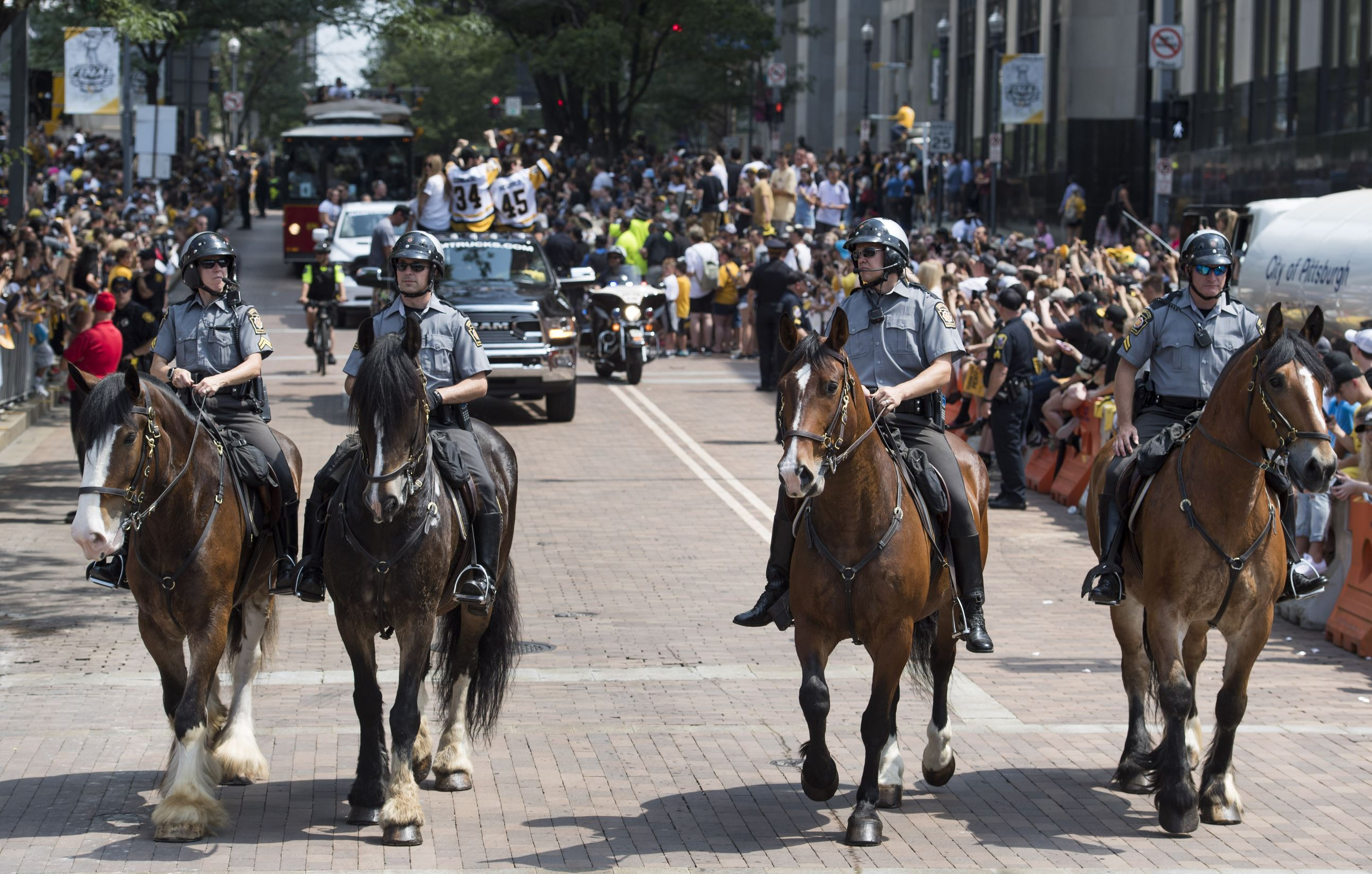 20170614scPoliceHorse02-1 Police horses ride in the Penguins victory parade on Wednesday at Grant Street and Boulevard of the Allies.