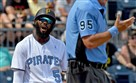 The Pirates' Josh Harrison talks back to home plate umpire Tim Timmons after a called strike three against the Cubs in the eighth inning Sunday.