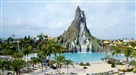 Waturi Beach and wave pool greet guests as they enter Volcano Bay water park.