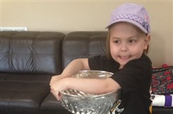 Darran Dunlap, daughter of Fan Morning Show host Colin Dunlap, with the Stanley Cup on Saturday, June 17, 2017. Penguins equipment manager Danny Kroll surprised 6-year-old Darran with the Cup. Darran was diagnosed with leukemia last November.