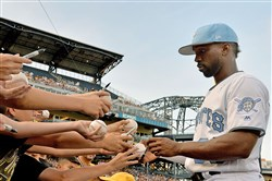 Andrew McCutchen signs autographs last weekend.