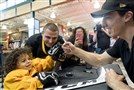 RJ Sent, 3 and of Cranberry, fist bumps Penguins goalie Marc-Andre Fleury during an autograph session Tuesday at Dick's Sporting Goods in Cranberry.