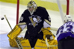 Marc-Andre Fleury wore bright yellow pads that clashed with the Penguins' color scheme when he debuted with the team in 2003.