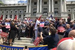 Gov. Tom Wolf addresses a Teamsters rally on the steps of the Capitol June 20.