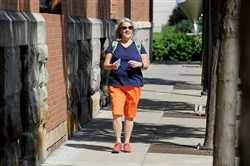 Lisa Valentino meanders along 24th Street in the Strip District, checking off another street in her quest to walk every one in Pittsburgh.