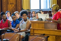 From left, Auji Vaughn, K'aijha Gomez, Amajah Hall and Nia Arrington, all members of the Youth Participatory Budget Council, listen to public comments during a City Council meeting Wednesday at the City-County Building, Downtown.
