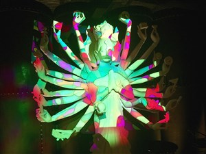 A view of a statue of the Buddha, which is in colorful light in a dining room at Social House 7, Downtown.