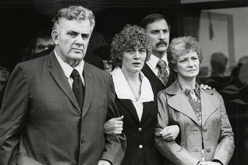 Members of Gregory Adams' family leave his funeral. From left are: his father Benjamin Adama, wife Mary Ann, brother-in-law Richard Sullivan, and sister Angela Adams.