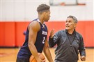 Head coach Keith Dambrot talks to Eric James during Duquesne practice last Thursday.