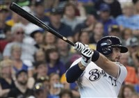 The Brewers' Travis Shaw hits an RBI double in the fifth inning of a against the Pirates Thursday in Milwaukee.