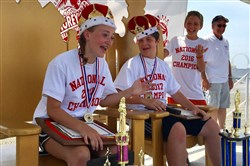 Sierra Ricci, 12, of Shaler and Eli Murphy, 14, of Squirrel Hill sit on their thrones Thursday after winning the national title in their respective divisions at this year's marbles tournament in Wildwood, N.J.