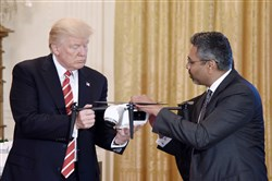 President Donald Trump holds a drone as George Mathew — CEO and chairman of Kespry — explains how it works during  the American Leadership in Emerging Technology Event in the East Room of the White House on Thursday in Washington, D.C.