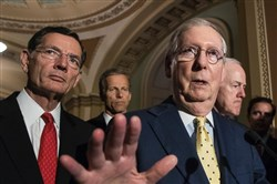 Mitch McConnell, right, addresses the Senate health care bill after a closed-door Republican strategy meeting Tuesday.