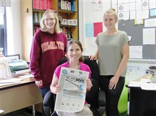 Salem High School juniors Ellian Chalfant, left and Alexandra Thomas, right, wrote the fake news story for the SunDevil Times. Kathleen Trace, seated, is an English and journalism teacher for the Salem High School newspaper in Virginia Beach, Va.