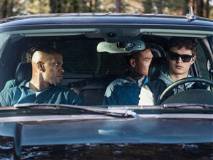 """Ansel Elgort, front right, with Jamie Foxx, left, and Lanny Joon in the film """"Baby Driver."""""""