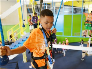 Tyler Wilkes, 11, of the Hill District makes his way across an obstacle along the new Ropes Challenge at Carnegie Science Center's Highmark SportsWorks on the North Shore. The 20-foot-high single-level course opened to the public this week.