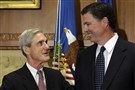 In this Sept. 4, 2013, photo, then-outgoing FBI Director Robert Mueller, left, talks with then-incoming FBI Director James Comey.