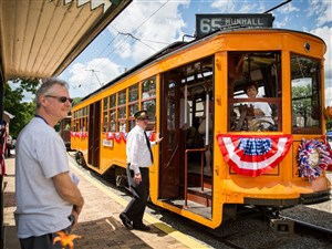 The crew of Pittsburgh Railways Company car 4398, which celebrates its 100th birthday in 2017, waits for passengers to finish boarding during the Parade of Trolleys event at the Pennsylvania Trolley Museum on Saturday in Washington.