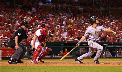 The Pirates' John Jaso hits a game-winning solo home run in the ninth inning Saturday at Busch Stadium.