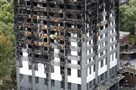 The facade, installed last year at Grenfell Tower, in panels known as cladding and sold as Reynobond PE, consisted of two sheets of aluminum that sandwich a combustible core of polyethylene. It was produced by the American manufacturing giant Alcoa, which was renamed Arconic after a reorganization last year. The burnt Grenfell Tower apartment building standing testament to the recent fire in London, Friday.