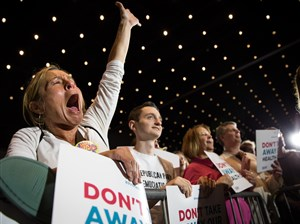 A woman cheers before Senator Bernie Sanders speaks Saturday during the Don't Take Our Health Care rally in Pittsburgh in Downtown.
