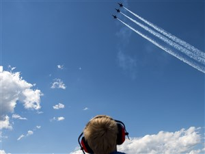 Asher Smolleck, 5 of Latrobe, watches the United States Navy Blue Angels during the Shop 'n Save Westmoreland County Airshow on Sunday, June 25, 2017 at Arnold Palmer Regional Airport in Unity. (Steph Chambers/Post-Gazette)