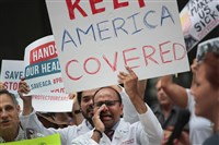 Demonstrators protest changes to the Affordable Care Act Thursday in Chicago.