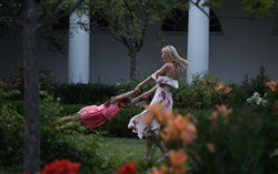 Ivanka Trump, daughter and assistant to President Donald Trump, plays with her daughter Arabella Rose Kushner  the Rose Garden during during a Congressional Picnic on the South Lawn at the White House on Thursday, June 22.