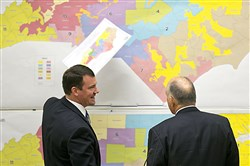 In this Tuesday, Feb. 16, 2016 file photo, Republican state Sens. Dan Soucek, left, and Brent Jackson, right, review historical maps during The Senate Redistricting Committee for the 2016 Extra Session in the Legislative Office Building at the N.C. General Assembly, in Raleigh, N.C. An Associated Press analysis, using a new statistical method of calculating partisan advantage, finds traditional battlegrounds such as Michigan, North Carolina, Pennsylvania, Wisconsin, Florida and Virginia were among those with significant Republican advantages in their U.S. or state House races in 2016.