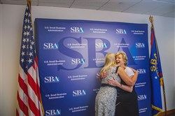 Linda McMahon, administrator of the Small Business Administration, hugs Kathleen Sarniak-Tanzola, president and CEO of Jeannette Specialty Glass, on Monday after a discussion with small business owners at the agency's office in Downtown.
