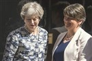 Britain's Prime Minister Theresa May welcomes Democratic Unionist Party leader Arlene Foster, right, outside 10 Downing Street in London on Monday.