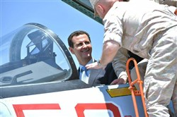 A handout picture released on the official Facebook page of the Syrian Presidency on Tuesday shows President Bashar Assad sitting inside a Sukhoi Su-27 during his visit to the Hmeimim military base in Latakia province, in the northwest of Syria.