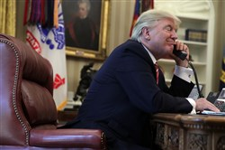 President Donald Trump speaks on the phone with Irish Prime Minister Leo Varadkar in the Oval Office of the White House on Tuesday in Washington, D.C.
