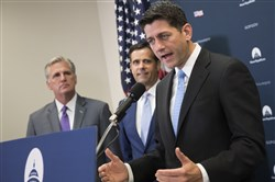 House Speaker Paul Ryan, R-Wis., right, joined by, from left, House Majority Leader Kevin McCarthy of Calif., and Rep. John Ratcliffe, R-Texas, meets with reporters following a GOP strategy session, Tuesday.