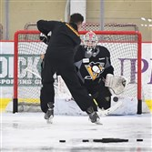 Penguins goalie Stephen Dhillon makes a save Wednesday during the first day of Penguins development camp at the UPMC Lemieux Sports Complex in Cranberry.