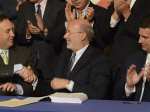 Democratic Gov. Tom Wolf shakes hands with Senate Majority Leader Jake Corman earlier this month.