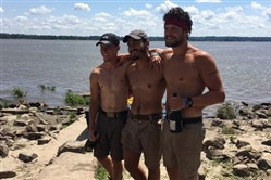 From left, Tyler Brezina, Jackson Gray and Quinton Couch stand on the banks of the Mississippi River in Cairo, Ill., on Thursday, more than two months and 981 miles after departing from Pittsburgh.