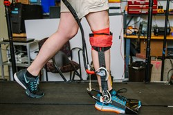 Kirby Witte, a Ph.D. student in mechanical engineering, tests a prototype of an exoskeleton last month in a lab at Carnegie Mellon University.