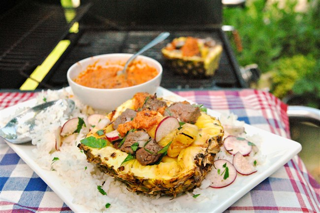 Sirloin Pineapple Boats with Chili de Arbol Salsa will add pizzazz to your Fourth of July meal.
