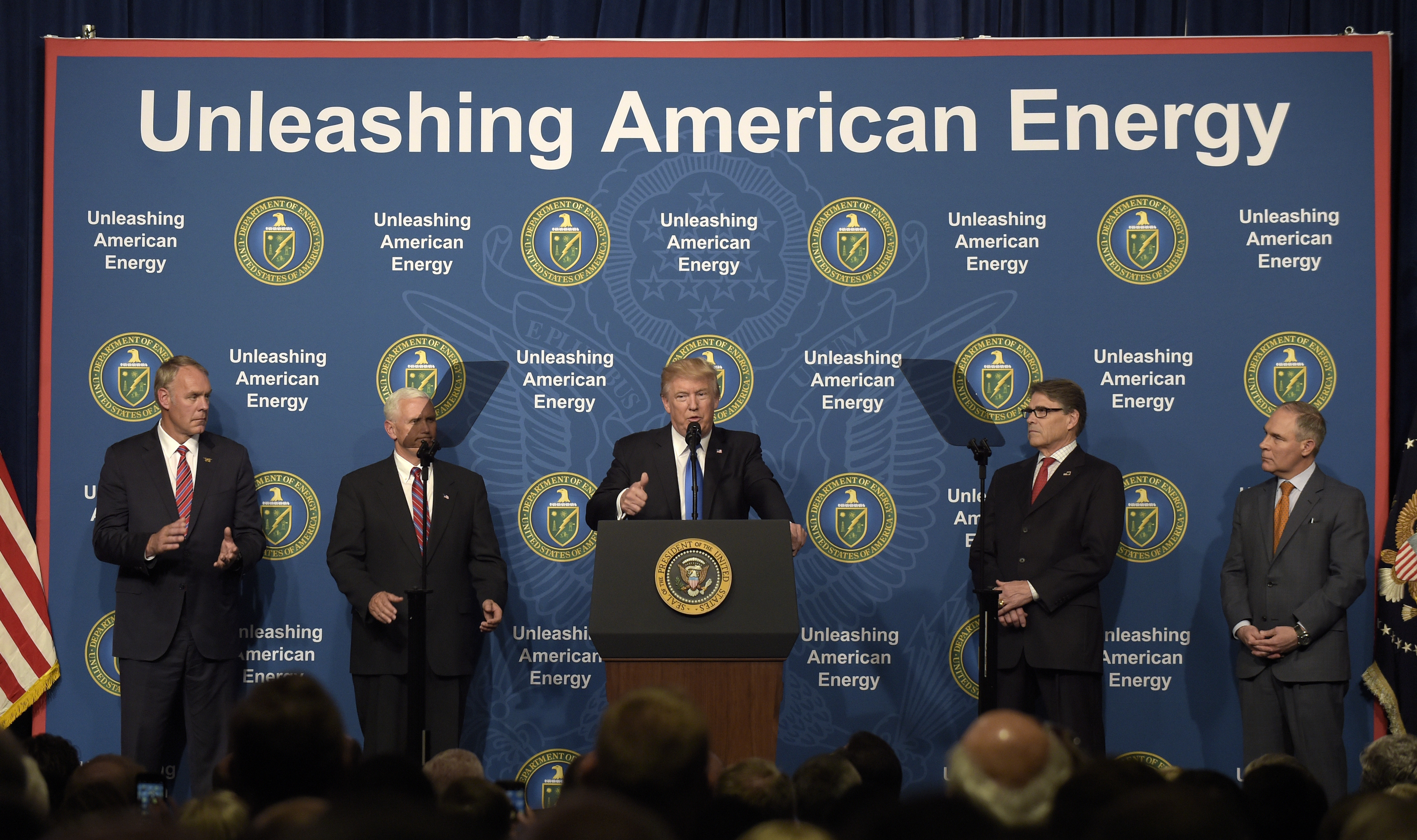 Trump-1 President Donald Trump, center, standing with from left, Interior Secretary Ryan Zinke, Vice President Mike Pence, Energy Secretary Rick Perry and Environmental Protection Agency Administrator Scott Pruitt, speaks at the Department of Energy in Washington, Thursday, June 29, 2017. (AP Photo/Susan Walsh)