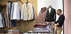 A manager at Bonobos Guideshop arranges clothing at the store's Financial District location in New York City.