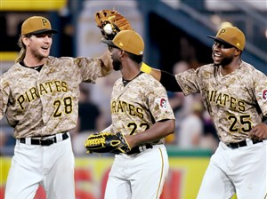 The Pirates' John Jaso, Andrew McCutchen and Gregory Polanco celebrate after defeating the Rays June 29 at PNC Park.