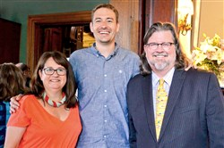 John and Suzanne Graf, owners of the Priory Hospitality Group, and Ian Rosenberger, center, founder and CEO of Thread International.