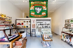 "Rita Duffy's functional souvenir shop opens ""so it is."" In Ms. Duffy's installation, nearly every item is an actual souvenir for sale, and all have an underlying political or historical message."