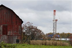 In this 2011 photo, a drilling rig is set up to tap gas from the Marcellus Shale gas field, near a barn in the Susquehanna County township of Springville, Pa.