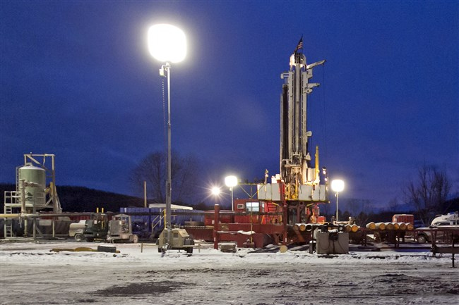 This 2013 photo shows a natural gas drilling site in the Susquehanna County township of New Milford, Pa. This lean year for Pennsylvania's shale gas impact fee collections likely won't be followed by another, according to new projections from the state's Independent Fiscal Office. (AP Photo/Richard Drew, File)
